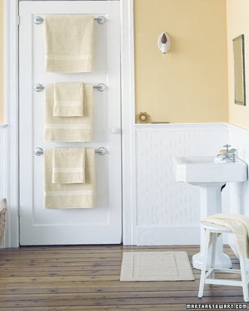 Use towel rods to hang towels on the back side of the door